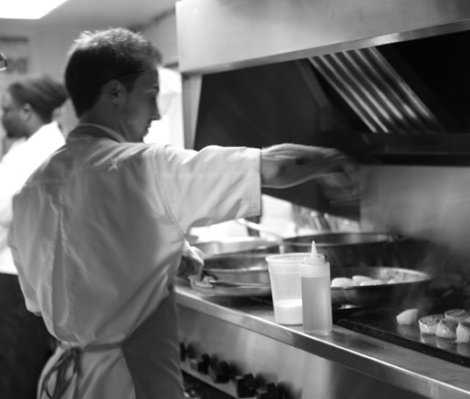 a chef at work in the James Beard House kitchen