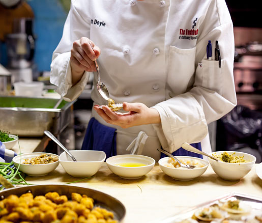 A student volunteer in the James Beard House kitchen
