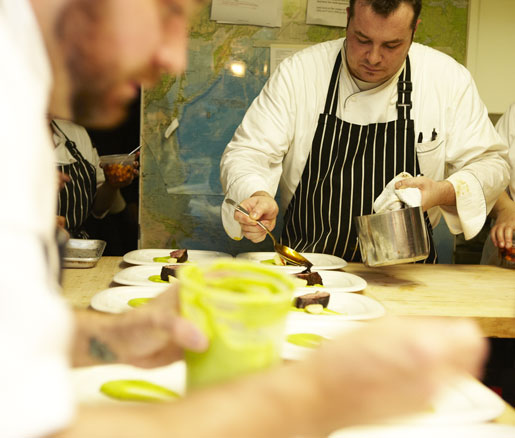 chefs plating in the James Beard House kitchen