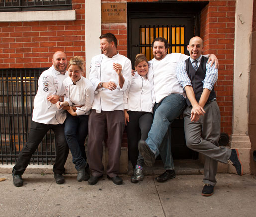 Chefs pose for a photo in front of the James Beard House