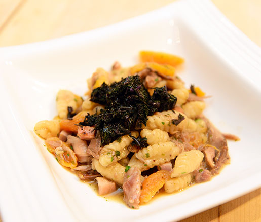 Braised Local Pheasant Cavatelli with Sumac, Stone Fruits, and Mustard Green Gremolata
