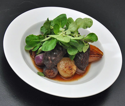 Chef Sondra Bernstein's recipe for braised pork cheeks with three-onion ragoût, adapted by the James Beard Foundation