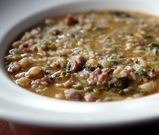 Michael Bologna's recipe for white bean and sausage stew, adapted by the James Beard Foundation