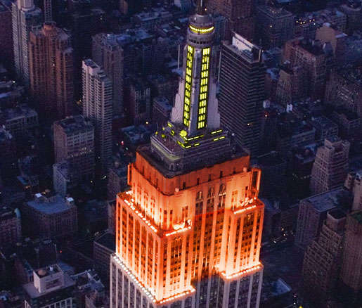 The Empire State Building shining orange and yellow for the James Beard Foundation