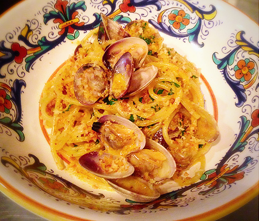 Spaghetti with Clams, 'Nduja, Sugo, and Parsley