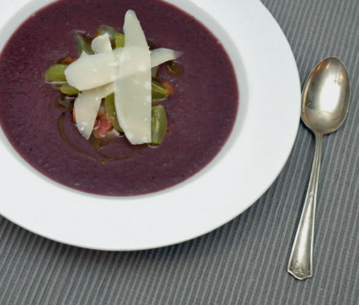 Recipe for Red Cabbage Soup with Crispy Guanciale, Parmigiano-Reggiano, and Grapes, adpated by the James Beard Foundation