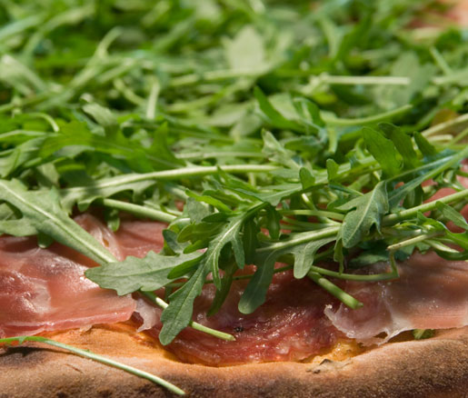 Wolfgang Puck's recipe for pizza with prosciutto and arugula