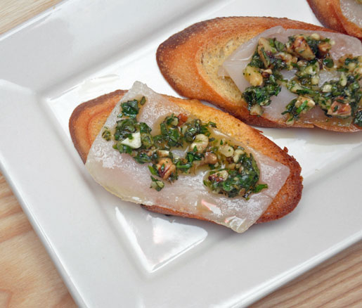 Recipe for lardo and walnut pesto crostini, adapted by the James Beard Foundation