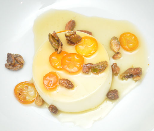 Bronwen Wyatt's recipe for Meyer Lemon Panna Cotta with Candied Kumquats and Sea Salt–Roasted Pistachios, apdated by the James Beard Foundation