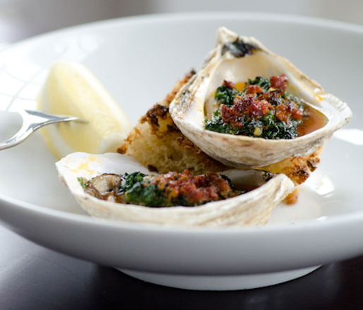 Recipe for Roasted Clams with Herb Jam and Chorizo Butter, adpated by the James Beard Foundation