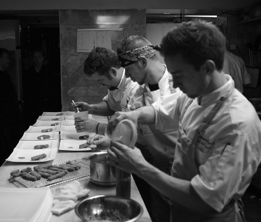 Chefs assemble dishes in the James Beard House kitchen