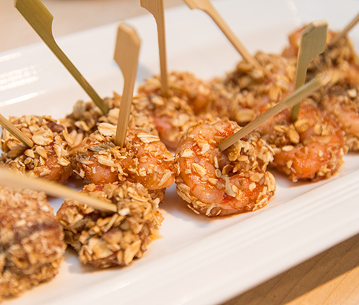 Bitters-Poached Gulf Shrimp with Toasted Oats, Honey, and Candied Pecans