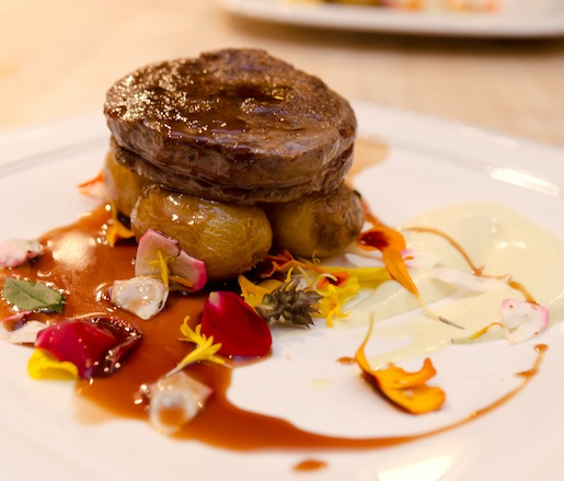 Roasted Storm Hill Rib-Eye with Duck Fat Potatoes, Truffled Corn Mousse, Local Blossoms, and Sangiovese Reduction