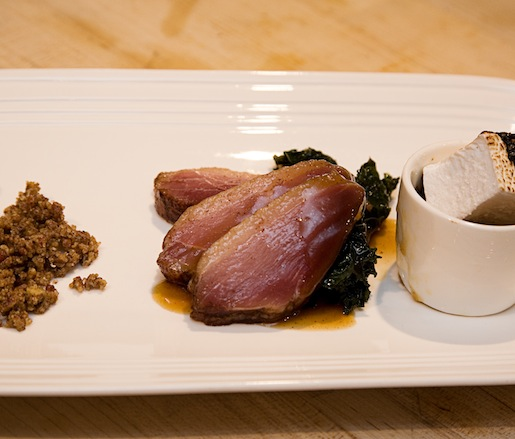 Smoked Steen's Cane Syrup and Abita Root Beer–Cured Louisiana Duck Ham with Brown Sugar, Pecan, and Sweet Potato Soufflé; Brûléed Housemade Marshmallows; Clove, Brown Butter, and Toasted Pecan Crumble; Orange Gastrique; and Bacon-Sautéed Kale