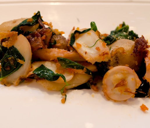 Warm Spanish Octopus Salad with Pimentón, Fermented Black Garlic, Guanciale, and Pea Shoots