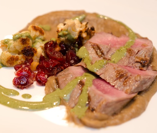 Grilled Oregon Lamb Loin with Caramelized Sunchoke Purée, Roasted Cauliflower, Pine Nuts, Cranberries, and Charred Herb Vinaigrette