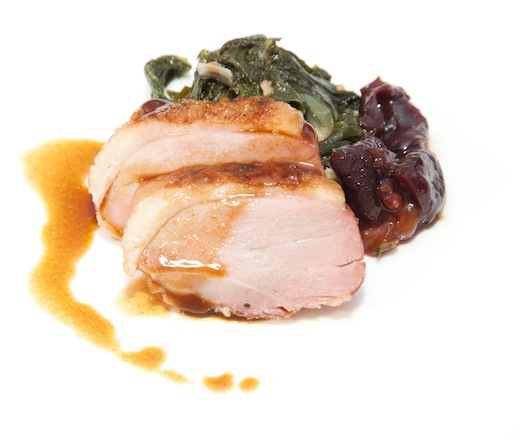 Smoked White Pekin Duck Breast with Preserved Northwest Cherry Compote and Braised Collard Greens