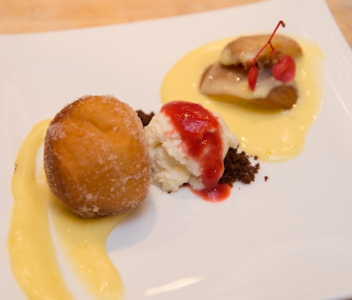 Vanilla Bean Panna Cotta with Chocolate Crumble, Lemon Beignets, and Roasted Stone Fruit–Icewine Sabayon