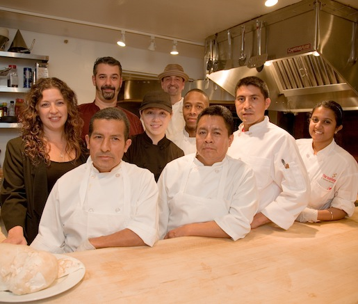 Lisa Tassone and Thomas Giudice and their chef team in the Beard House kitchen
