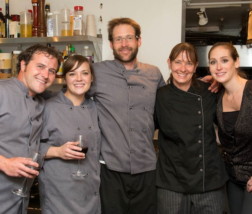 Chef Kate Ladoulis and her team in the Beard House kitchen
