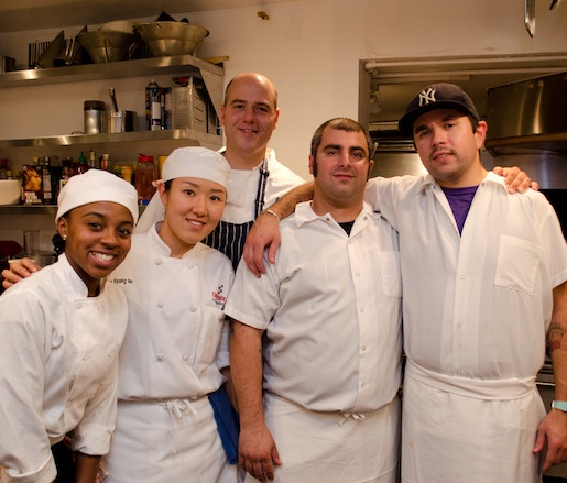 Chefs Joe Cassinelli and Danny Bua, Jr. and their team in the Beard House kitchen