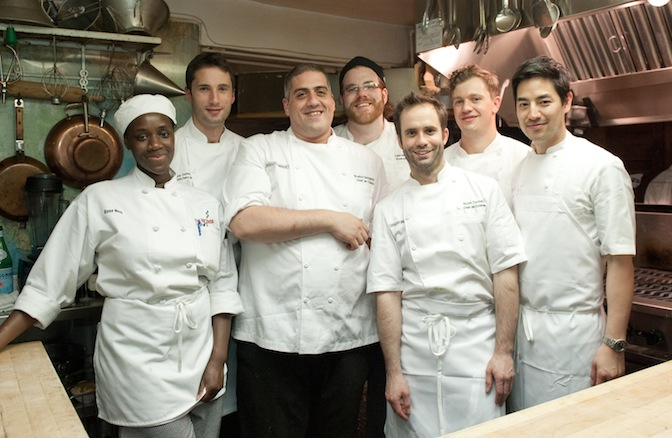 Chefs Stratos Georgedakis, Scott Tacinelli, and their team in the Beard House kitchen