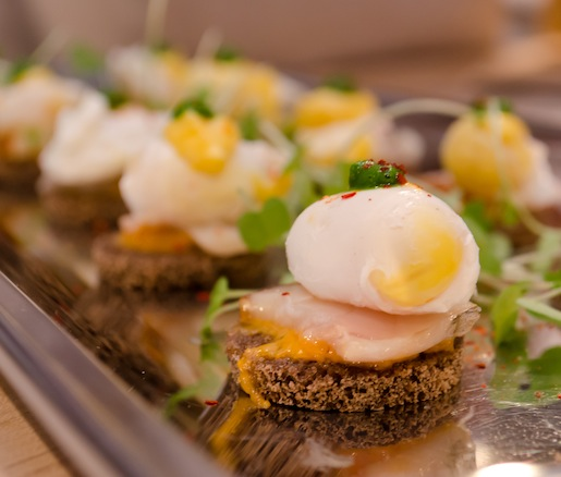 Petit Eggs Benedict > Quail Eggs with Smoked Sable and Pacific Sea Urchin–Piment d'Espelette Hollandaise