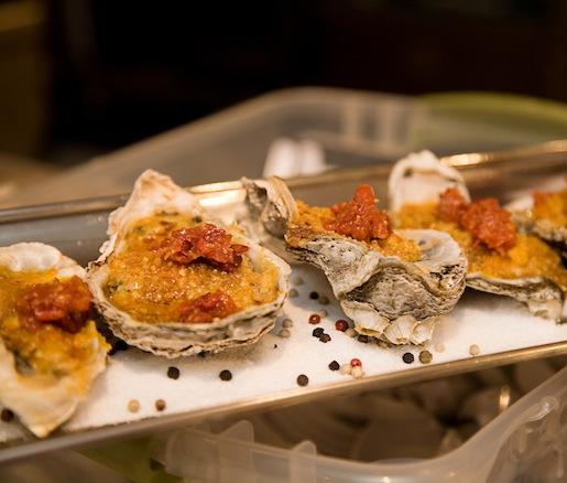 Char-Broiled Louisiana Oysters with Garlic, Lemon, and Pernod Butter; Smoked Duck Crackling–Parmesan French Bread Crumbs; and Bacon, Onion, and Fennel Jam
