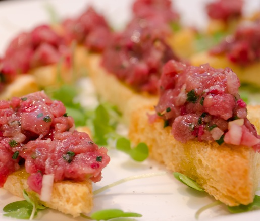 Delmonico's Steak Tartare with White Soy, Radishes, Pea Shoots, and Truffles