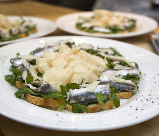 White Anchovies, Lemon, Arugula, and Shaved Parmigiano-Reggiano on Crostini