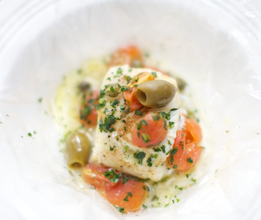 Reinterpreted Acqua Pazza–Style Sea Bass with Tomatoes, Herbs, Lemon, and Olives