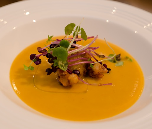 Roasted Butternut Squash Bisque with Spiced Pumpkin Beignets and Lake Meadow Farms Duck Leg Confit