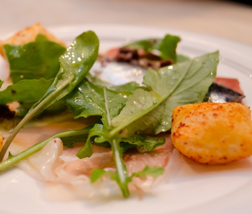 Smuggled Culatello with Pickled San Sebastián Sardines, Raw Jerusalem Artichokes, Wild Arugula, and Cuquillo Olives