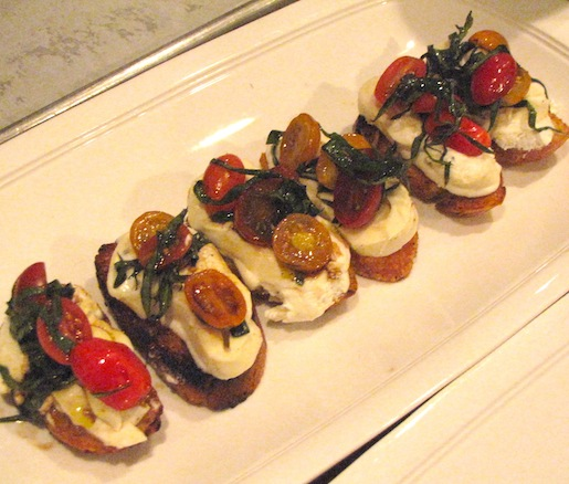 Housemade Burrata Crostini with Wilted Tomatoes and Basil