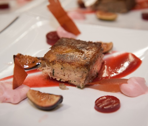 Crispy Duck Confit Pavé with Cranberry Emulsions, Acacia Honey–Torched Figs, and Frilly Mustard Greens