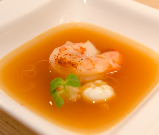 Panamanian Soup with Shrimp, Yams, Poached Quail Egg, Coriander Powder, Kadaif Noodles, and Micro-Cabbage