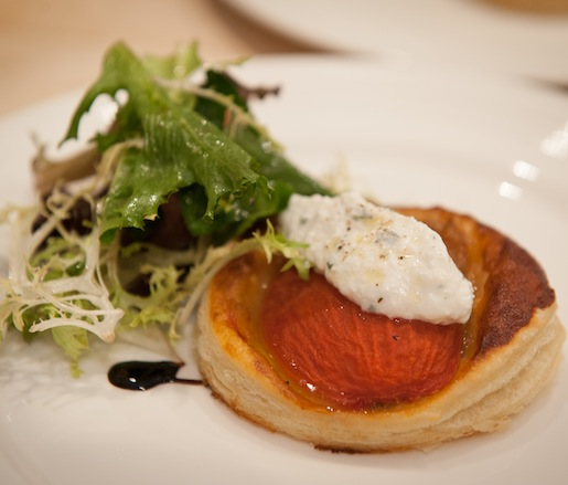 Oven-Roasted Roma Tomato–Caramelized Onion Puff Pastry Tart with Housemade Ricotta and Field Greens