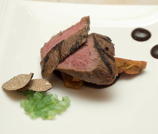Cedar Paper–Roasted Anderson Ranch Lamb Loin with Chanterelle and Lobster Mushrooms, Black Garlic, and Oregon Truffle–Douglas Fir Jelly