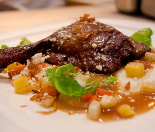 Duck Leg Cazuela with Oaxaca Grits, Fall Vegetables, Brussels Sprouts, Chicharrones, and Smoked Morita Chili Salsa
