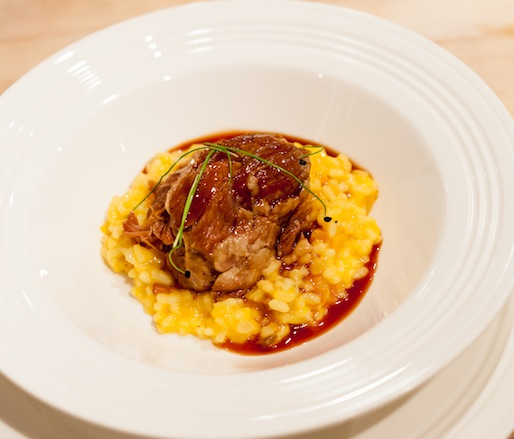 Pork Confit with Local Pumpkin–Andouille Sausage Risotto and Syrah Reduction