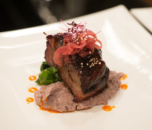 Hickory-Smoked Short Ribs with Blue Corn Grits, Swiss Chard, and Orange–Chipotle Glaze