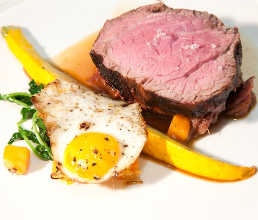 Texas Grass-Fed Beef Tenderloin and Mesquite-Smoked Beef Short Rib with Grilled White Heirloom Radicchio and Texas Peaches, Fried Quail Egg, and Smoked Castelvetrano Olive Sauce