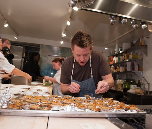Chef Richard Blais plating oysters
