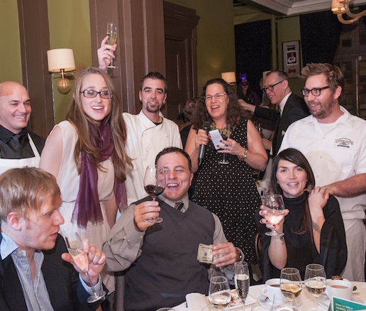 Chef Geoff Johnson, members of his team, and guests toast to 2013