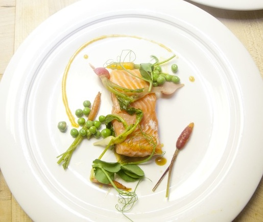 Sous Vide Wild Salmon with Baby Root Vegetables, Peas, Breakfast Radishes, Ginger Balsamic, and Lavender Foam