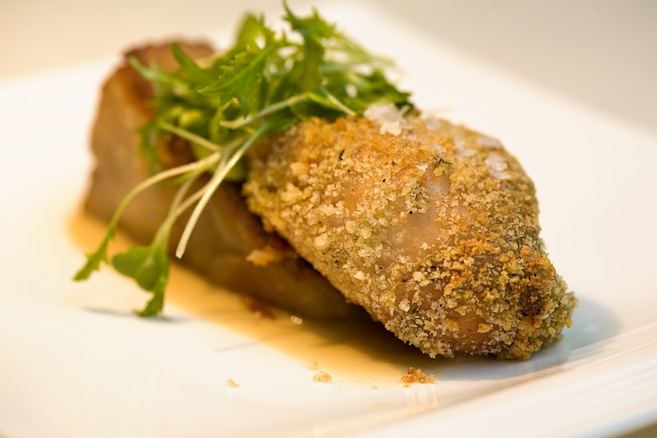Fava Bean and Raclette Cheese–Stuffed Pat's Pastured Chicken Drumstick with Crispy Pommes Anna and Green Garlic Cream