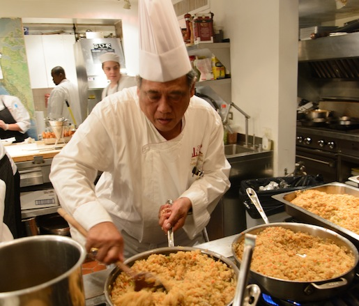 Chef Purnomo behind the scenes at the James Beard House, making fried rice