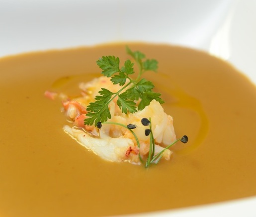 Lobster Bisque with Sherry–Cream Broth, Coral Butter, and Fine Herbs