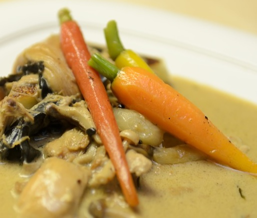 Braised Rabbit with Cognac–Dijon Jus, Wild Mushrooms, Winter Savory, Pearl Onions, Heirloom Carrots, and Grilled Polenta