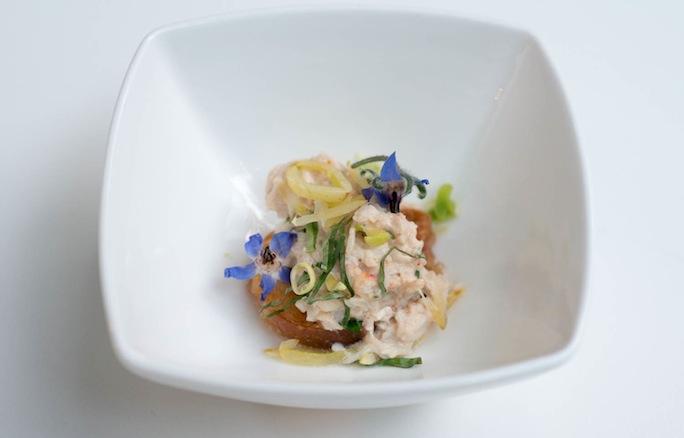 Peekytoe Crab Salad with Yellow Sugar Snap Peas and Borage Flowers on Crostini